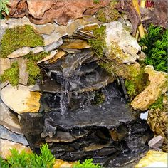 A natural looking start to a pondless waterfall?