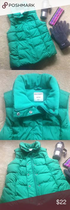 Kelly green Old Navy puffer vest In new condition! Fleece lined puffer vest worn ONCE! Zipper and snap close front. Side pockets with fleece lining keep your hands warm and cozy. This vest is amazingly soft and incredibly warm. Vibrant color for the winter months! A perfect Xmas gift too! Size XS. Old Navy Jackets & Coats Puffers