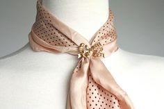 If you've got a dainty little vintage scarf that's too small to tie, gather it with a brooch or ring.