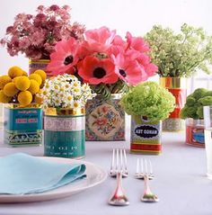 Great DIY idea for a garden party or luncheon.  A simple array of fresh cut flowers in vintage tins.