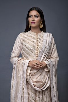 Uniquely designed diagonal Lucknowi Chikankari & Mukaish hand embroidered in a classic biscuit color suit. Pakistani Fashion Party Wear, Pakistani Wedding Outfits, Pakistani Dress Design, Pakistani Couture, Pakistan Fashion, India Fashion, Ethnic Fashion, Women's Fashion, Indian Attire