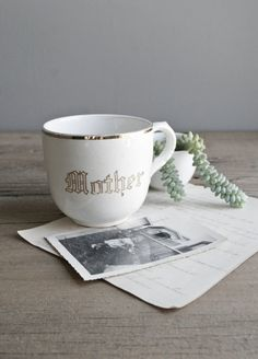 "gold rimmed coffee cup with beautifully lettered, ""mother"""
