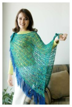 The open knit appearance is created by skipping every other peg as you knit.  Skill Level: Intermediate  You will need:  * Knifty Knitter Yellow Round Loom  * Yarn Needle  * Hook  * Crochet Hook  * 5 skeins of Kitty Italian Fashion Accent yarn  * 1 skein Lion Brand Yarn, Micro Spun, in bright blue