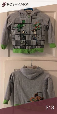 Buzz light Year Toddler Hoodie Made of Cotton with a Hood attached.  No stains zipper in tact.  Great condition Jackets & Coats
