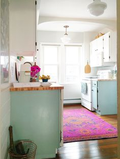 Feeling that post-holiday winter gloom? Let us perk you up with a little eye candy on this fine Tuesday morning. Enter Lauren's fabulous, flirty, and oh-so-colorful kitchen, which she transformed as part of Apartment Therapy's Style Cure last fall. Just wait till you see what it used to look like...