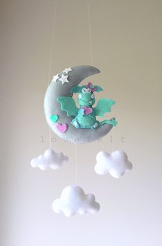 Baby mobile dragon mobile baby mobile dragon by lovefeltmobiles Owl Mobile, Baby Mobile, Dragon Mobile, Dragon Nursery, Baby Dragon, Dragon Moon, Felt Animals, Felt Crafts, Baby Gifts