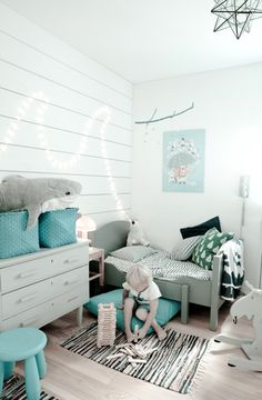This white and blue bedroom would look very fetching with a set of Mockingbird Street sheets in the cot!