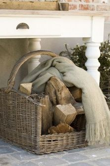 Who would have dreamed up such a cute prim touch... to add a soft scarf to a basket of fire wood!  Awesome!