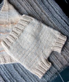 Love these simple knit in one piece (no seams) soaker/diaper cover.  Classic, simple, sweet.