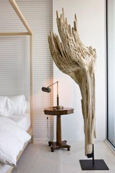 california modern beach house interiors - bedrooms with tall driftwood sculpture lampe - Google Search