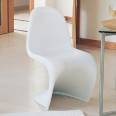 A chair that features a classic 60's futurist design. Made of one curved piece of plastic which almost flows, these chairs add a statement to any dining area. They can also be stacked for easy storage.