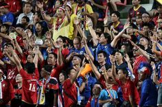 Fans cheer during the international friendly match between Thailand XI and FC Barcelona at Rajamangala Stadium on August 7, 2013 in Bangkok, Thailand.