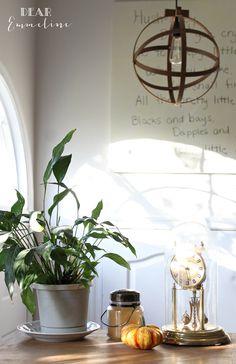 DIY orb light fixture using sewing hoops..i love the light fixture.