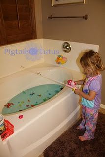 Fishing for magnetic letters in the bath tub -- great activity for winter days.