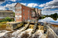https://flic.kr/p/54pBAx | Flour Mill on River Aire | Allinsons Flour Mill from Pedestrian Bridge over River Aire at Castleford. New bridge was opened in July 2008 and is a major part of the town generation scheme supported by Channel 4.