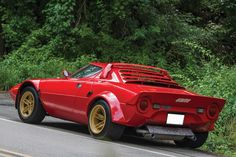 """1975 Lancia Stratos HF Stradale by Bertone The Stratos started life as a concept car at the Turin Motor Show in 1970, it was designed by Bertone and would set a trend in """"wedge-shaped"""" super car design that continues to the modern day. The relatively small Stratos was designed specifically for rallying – the first car ever designed solely with rally racing in mind."""