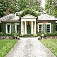 Louvered panels on both the front door and window shutters unite this facade in elegance, while a coat of garden-green paint on all players adds a kick of contrast to this cottage Traditional Front Doors, Traditional House, Traditional Shutters, Traditional Exterior, Green Shutters, Window Shutters, Cottage Shutters, House Elevation, Landscape Architecture