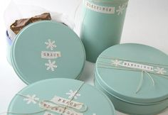 Upcycled spray painted cookie tins
