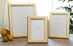 a gold frame with watch band detail is great for adding classic warmth to any room.