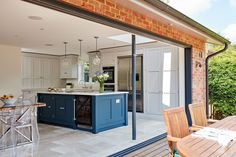 Blue Shaker Kitchen This shaker style blue kitchen has been designed with family in mind, full of state of the art appliances and hidden storage solutions. Open Plan Kitchen Dining Living, Open Plan Kitchen Diner, Living Room Kitchen, Kitchen Layout, Home Decor Kitchen, Interior Design Kitchen, New Kitchen, Home Kitchens, Kitchen Ideas