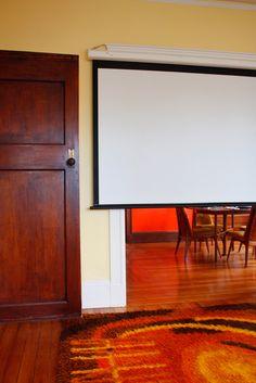 Drop-down projection screen in living room and upside down door :)