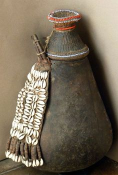 Africa | Decorated gourd vessel from the Borana people of Kenya | Leather, shells and glass beads.  Basketry lid