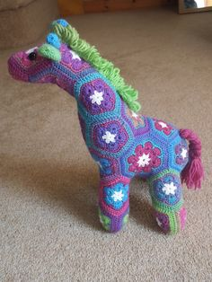 Jedi the African Flower giraffe Project here : http://www.ravelry.com/projects/meekko/jedi-the-curious-giraffe-african-flower-crochet-pattern-3