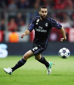 Dani Carvajal Photos Photos - Dani Carvajal of Real Madrid controles the ball during the UEFA Champions League Quarter Final first leg match between FC Bayern Muenchen and Real Madrid CF at Allianz Arena on April 12, 2017 in Munich, Germany. - FC Bayern Muenchen v Real Madrid CF - UEFA Champions League Quarter Final: First Leg