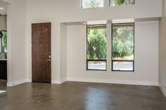 Great Room Entry with Concrete Floors and 8 foot Doors