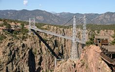 Royal-Gorge-Colorado.jpg (630×400) The bridge near Colorado Springs is considered the tallest suspension bridge in the U.S. It spans 1,260 feet over the Arkansas River, 960 feet below. The bridge is open to vehicle or pedestrian use which could be a fun hike if you like that sort of thing. Until 1982, visitors were accustomed to the feeling the whole bridge was swaying underfoot whenever a car drove over.