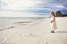 Toddler girl in white dress standing on the beach Denver, Colorado Child Photographer - The Vintage Cupcake Photograpaphy