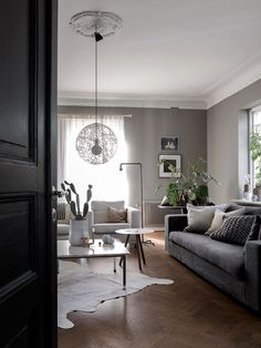 Cozy Scandinavian living room, grey-beige walls. Home of Daniella Witte