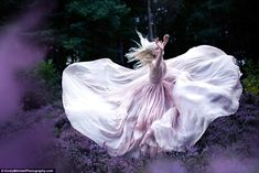 While Nightingales Wept: a model captured running though the woods near Kirsty Mitchell's home