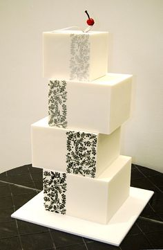 At the Walker Cake – based on the couple's wedding invitations and their art gallery venue. Topped with a miniature frosting version of the Walker Art Center's iconic Cherry and Spoon sculpture. By Gateaux Inc. Elegant and modern!