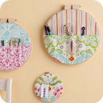 What a great idea! Embroidery hoops made into wall pockets to hold all your sewing do dahs. Fishsticks is the blog...