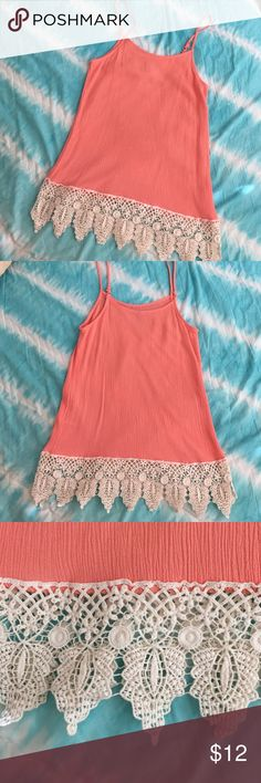 Peachy coral crochet bottom tank I really love this tank and they didn't have my size so I got an XS and it's just too small.  It's super cute, with a peachy coral gauze kind of fabric with really pretty crochet bottom. I wish I could keep it, it's just beautiful on and perfect for summer. I only wore it once, it's in perfect condition. I'd say if you are a 32B or less it will fit perfectly, it's just a little too tight around the top for me I'm a 32C. Vanity Tops Tank Tops