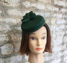 This Pillbox hat with veil dark green cocktail hat and fascinator veil green felt hat races hat formal wedding hat hat is just one of the custom, handmade pieces you'll find in our fascinators shops. Kentucky Derby, Green Fascinator, 1940s Hats, Holiday Hats, Wedding Hats, Formal Wedding, Pillbox Hat, Cocktail Hat, Stylish Hats