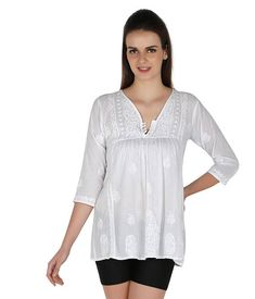 You can never go wrong with this white chikankari tunic crafted using pure Cotton  fabric especially for those women who love to flaunt their real self. And while the world is going organic and green in every sense, this beautiful chikankari tunic just lets you be in the flow—is handmade, minimalistic in its design yet high on its appeal and much in lines with today's fashion.     An integral part of Indian culture since 655AD, chinkankari has been strongly rekindled to match the taste of…