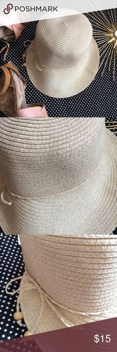 """[NWT August Hat Company] Classic Framer Sun Hat OS This hat is perfect for sunny days or a week at the beach. It is made of 100% Paper and has specks of gold throughout the weave of the hat. it has a tie detail around the front. NWT and one size.   Approximate measurements: Width 7"""", Front of brim to back 10.5""""  Item ships from a pet free, smoke free home. August Hats Accessories Hats"""
