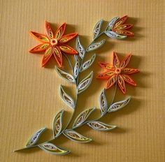 Quilled Flowers and Vines   I think I'm going to have to learn how to do this!!!