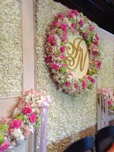 Flower backdrop for Thai wedding ceremony at 137 Pillars House, Chiang Mai.