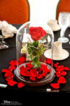 Disney themed wedding rose centerpieces for the reception - Beauty & the Beast. Love the rose petals!