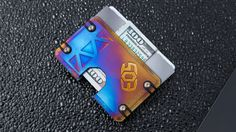 CNC machined metal wallet. Holds your cards and cash and also serves as a bottle opener.
