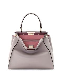 """Fendi Peekaboo bicolor leather tote bag. Golden hardware. Leather top handle with rings; 3.3"""" drop. Hinged hexagonal frame-top. Button-tabs at sides. Front and back turn-lock compartments. Contrast tw"""