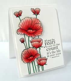 I love this stamp. She popped up some of the poppies for dimension.