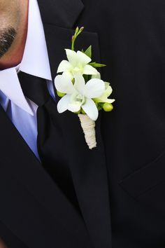 One of my favorite bouts...dendrobium orchids wrapped with raffia. See more at blessingsandblossoms.com