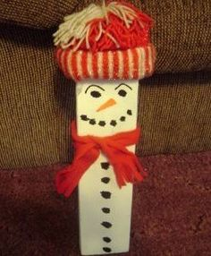 Snowman made from 2x4 inch piece of wood.
