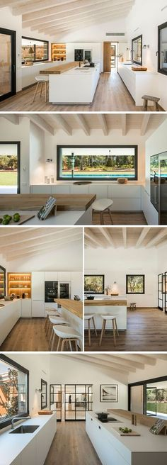 In the kitchen, a sloped ceiling creates a feeling of space, while the kitchen has been split up into three different work areas with a long wood bar top and island positioned in the middle. Throughout the kitchen, white minimalist cabinets are the main storage elements, while exposed wood shelving with back-lighting highlights a few favorite items. #KitchenDesign #ModernKitchen #KitchenLayout