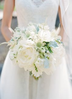 A close-up of Caroline's classic white bouquet made up of peonies and roses; photo by Sylvie Gil