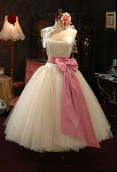 1950's wedding dress for classic wedding! I would have a bow the same color as the dress.